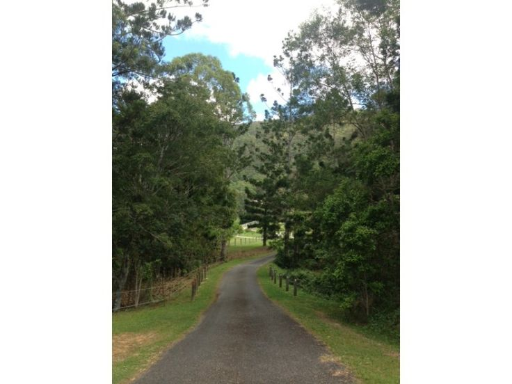 A pleasant drive from the Village leads to a private entry and tree lined drive past the horse paddocks, shed and shelter.