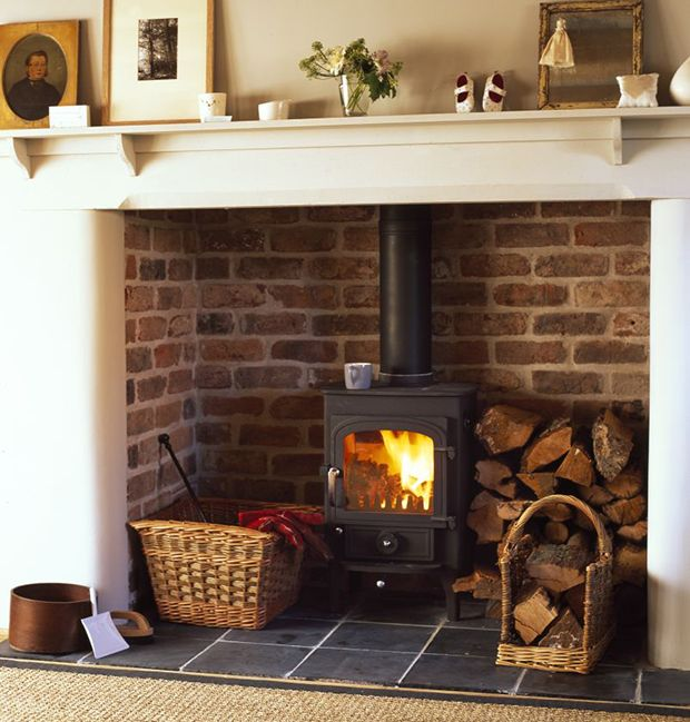Wood burner in fireplace with log stack
