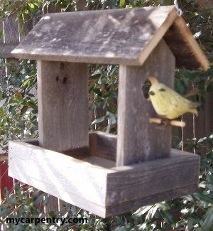 Here's a homemade bird feeder that is simple to make and is very functional.  One thing I like about this particular one is that the bottom that holds the bird seed is made of screen.