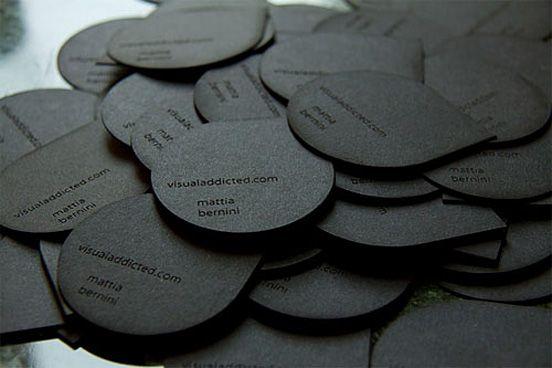 unusual: black, tear drop shaped premium business cards