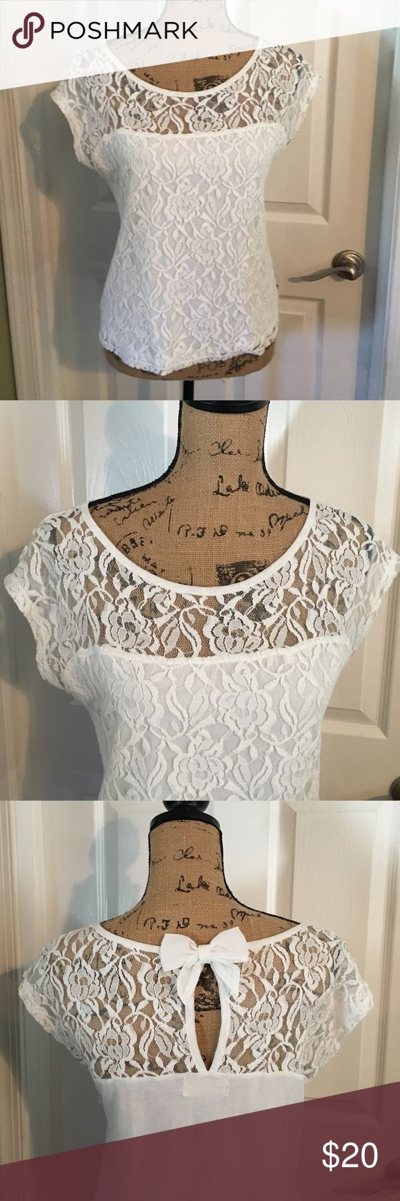 Hollister size medium white short sleeve top Hollister size medium white short sleeve top. Front of top is white lace. See through lace is just on the top above the chest. Round neck. The back is see through lace just at the top with a bow. In great condition. Only wore a couple of times. Hollister Tops