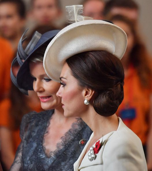 Catherine, Duchess of Cambridge talks with Queen Mathilde of Belgium as they attend commemorations marking the centenary of Passchendale in the town market square on July 30, 2017 in Ypres, Belgium.