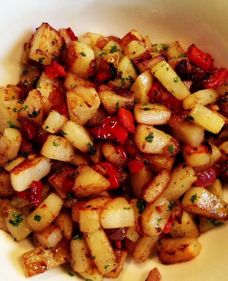 In a saute pan, over medium heat, add in the butter, potatoes, peppers and onions. Season with salt and pepper and a little garlic powder. Cook until the potatoes are fork tender then crank the heat just a bit to crisp up the potatoes a bit. Turn off the heat and stir in the parsley.