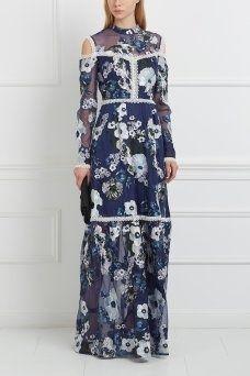 Шелковое платье Sabine Erdem. Платье в пол из синего шелка с цветочным узором станет отличным вариантом для светского мероприятия. Данная модель из коллекции Erdem имеет открытые плечи и декорирована отделкой из белого кружева. Платье стоит носить с босоножками или туфлями на высоком каблуке.