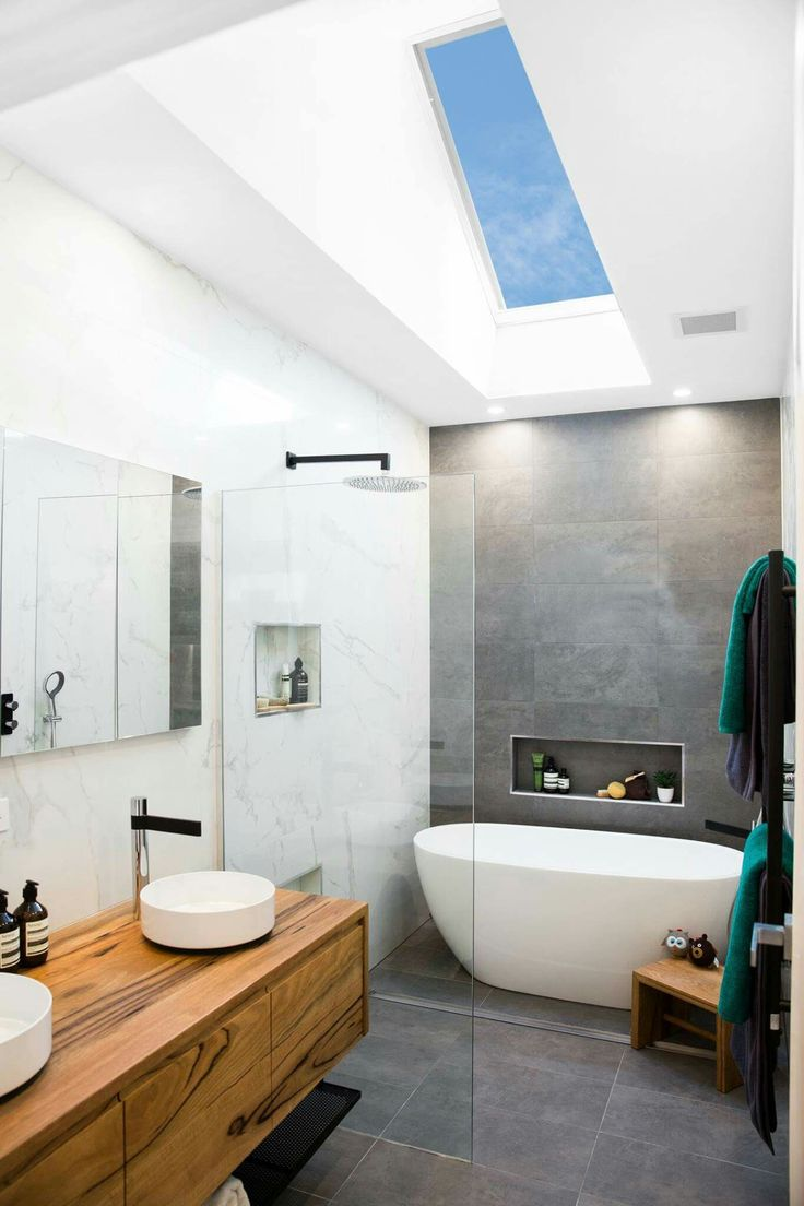 Wake up in the morning to a bathroom flooded with the morning sun. Forget the exhaust fan - open your Velux roof window at the touch of a button for that gentle morning breeze. Book your free Velux window quote at attix.com.au/contact-us and make sure your home is full of Vitamin D!!