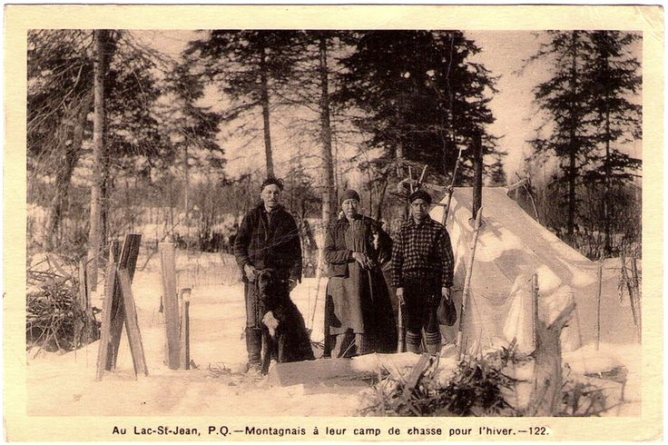 MONTAGNAIS (Innu) Indians from Mashteuiatsh Reservation (Pte-Bleue) at their winter hunting camp, Lac-St-Jean, Québec, c.1930. Photo by J. E. Chabot from Robertval. Real Photo Postcard edited between1920-1950