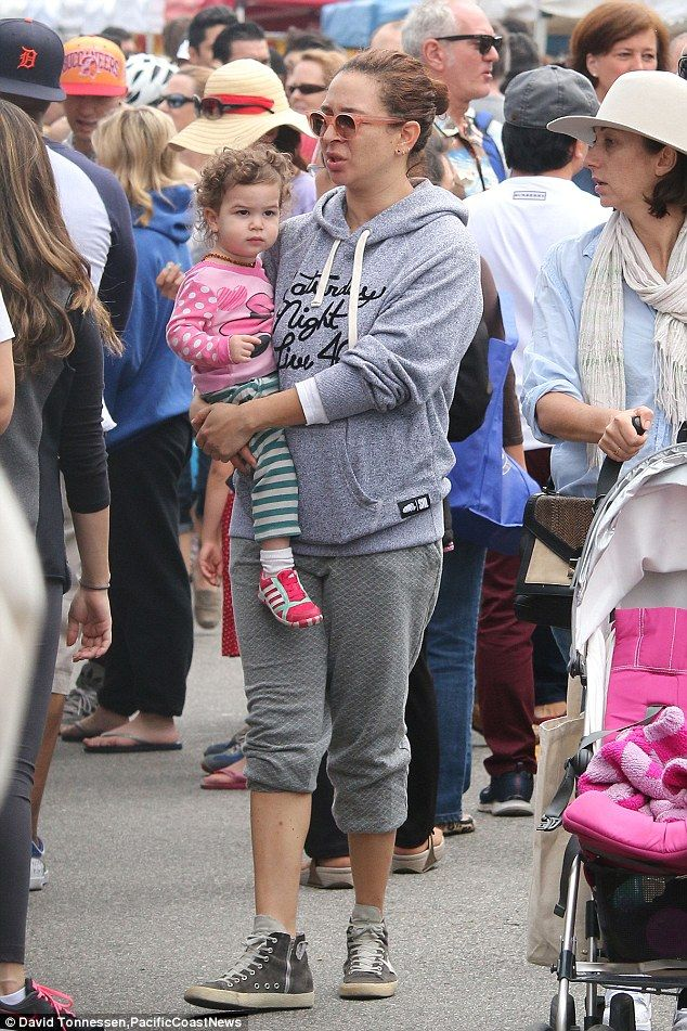 Motherly love: Maya Rudolph carried her daughter Minnie Ida while meandering through a Far...