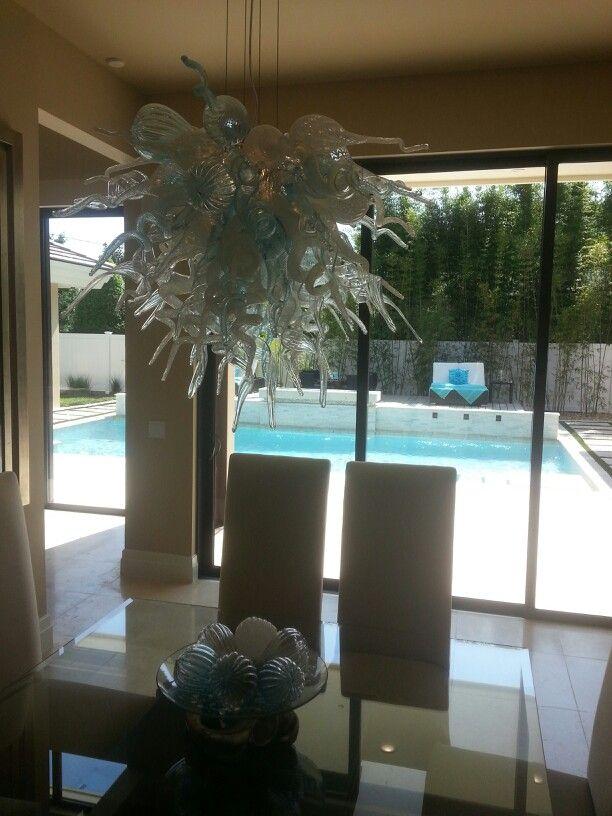 Orlando Parade of Homes 2014,  Chihuly fixture, dining room to pool. #ILUVWinterPark #interiordesign #lightfixture #diningroom #glassart #art
