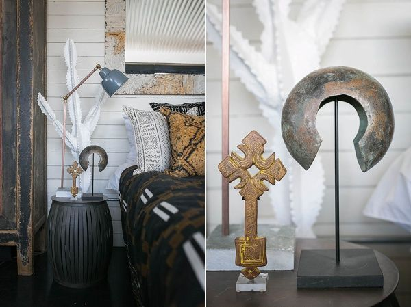 On the bedside table, in front of the Swazi-botanical, the Hunter-Gatherer has placed an Ethiopian cross, Congo anklet and a brass Indian lamp.