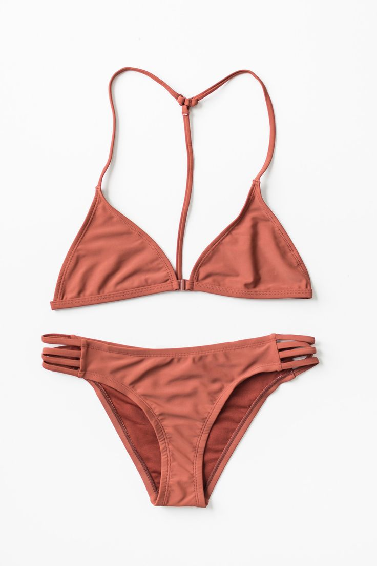 Rust color bikini top and bottom set. Featuring a non-padded triangle bikini top with an open T strap back. Hook closure in front. Adjustable straps for a more comfortable fit. Bottoms are low rise wi