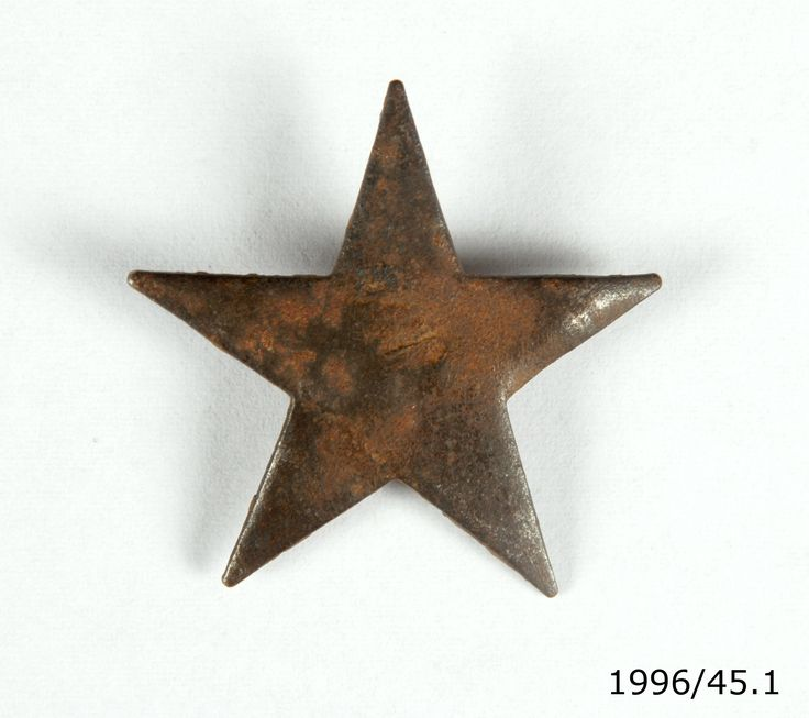 Japanese metal star badge (represents Japan's Imperial Army) for fitting to Japanese steel helmet. From the collection of the Air Force Museum of New Zealand.