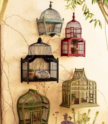 Birdcage Wall. Very creative and pretty way to display items in the garden. Or even inside.