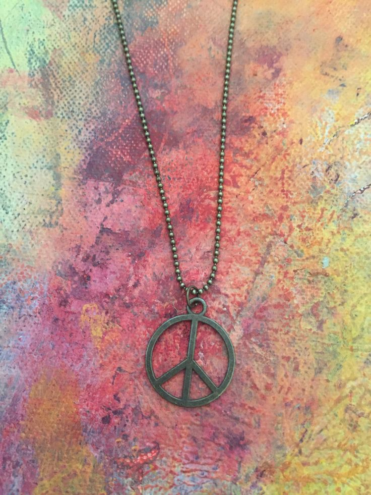 """Peace Sign Charm Necklace Description This playful peace sign charm necklace is made in brass ball chain. Size Length is: 22"""" Charm is .75"""""""