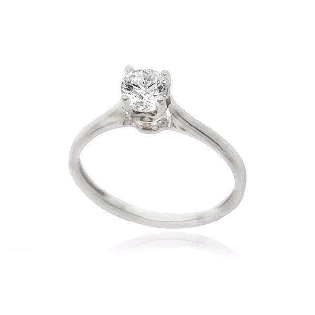 Μονόπετρο δαχτυλίδι σε λευκόχρυσο Κ.14 με λευκή πέτρα τοπάζ Swarovski και λευκές μικρότερες πετρούλες στο λαιμό του.