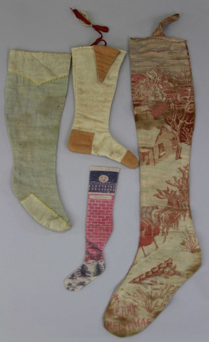 FOUR EARLY CHRISTMAS STOCKINGS