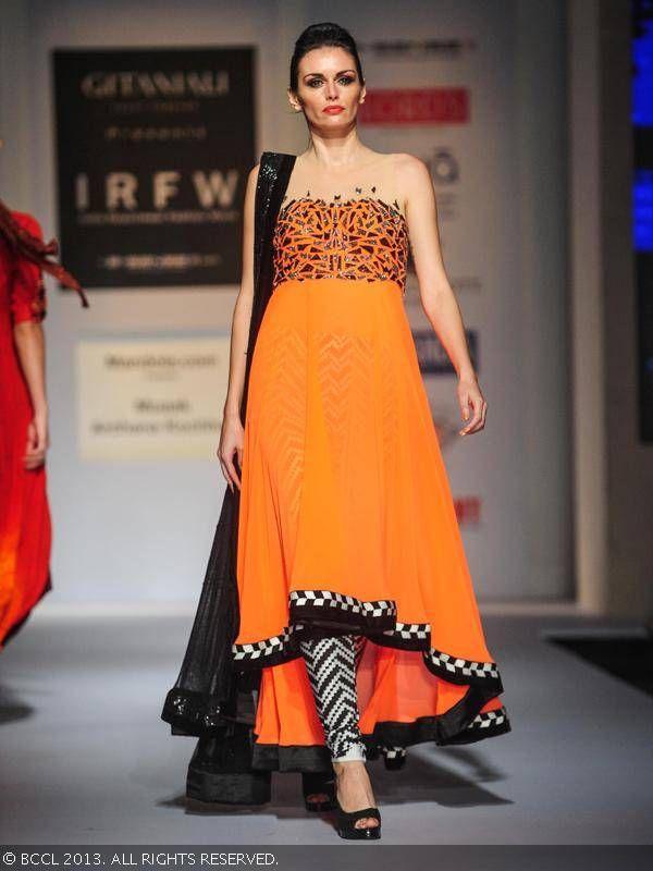 A model showcases a creation by designer Archana Kochhar during India Resortwear Fashion Week 2013, held at JW Marriott, in Mumbai.