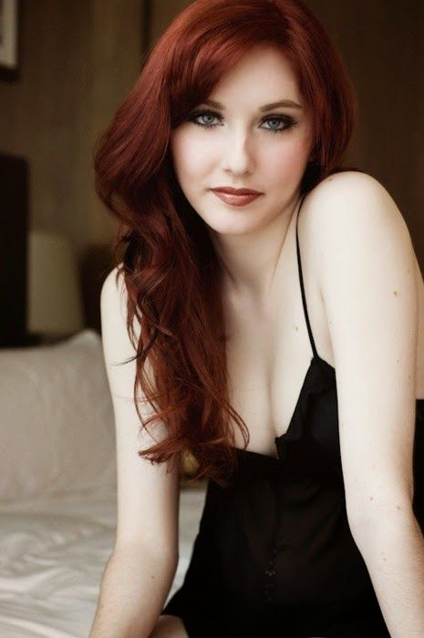 Beautiful auburn red hair. I really like this color.