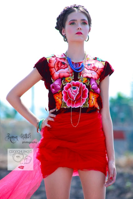Gorgeous Tehuana-style huipil with a bold, scarlet skirt creates a striking look!