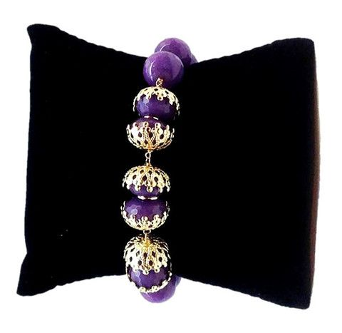 The vibrant #purple stones offer the right look to this fashion-foward #bracelet. Handcrafted in Brazil, 18k gold-plated Approximate length: 9 inches.