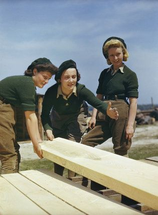 Lumber Jills being taught to saw wood at the Women's Timber Corps training camp at Culford in Suffolk. -- Imperial War Museum Prints