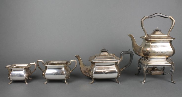 Lot 492, A silver 4 piece tea set with ebony mounts comprising octagonal teapot, ditto tea kettle on stand with burner, sugar bowl and cream jug, Sheffield 1912, 1913 and 1914, gross approx 2606 grams, est  £500-700