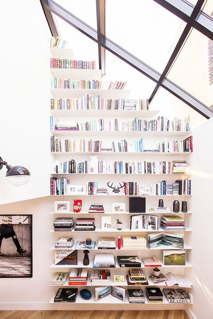 If a traditional bookcase isn't your thing, floor-to-sky floating shelves are a chic alternative that can be customized to any space. This bookshelf masters the art of the open book.