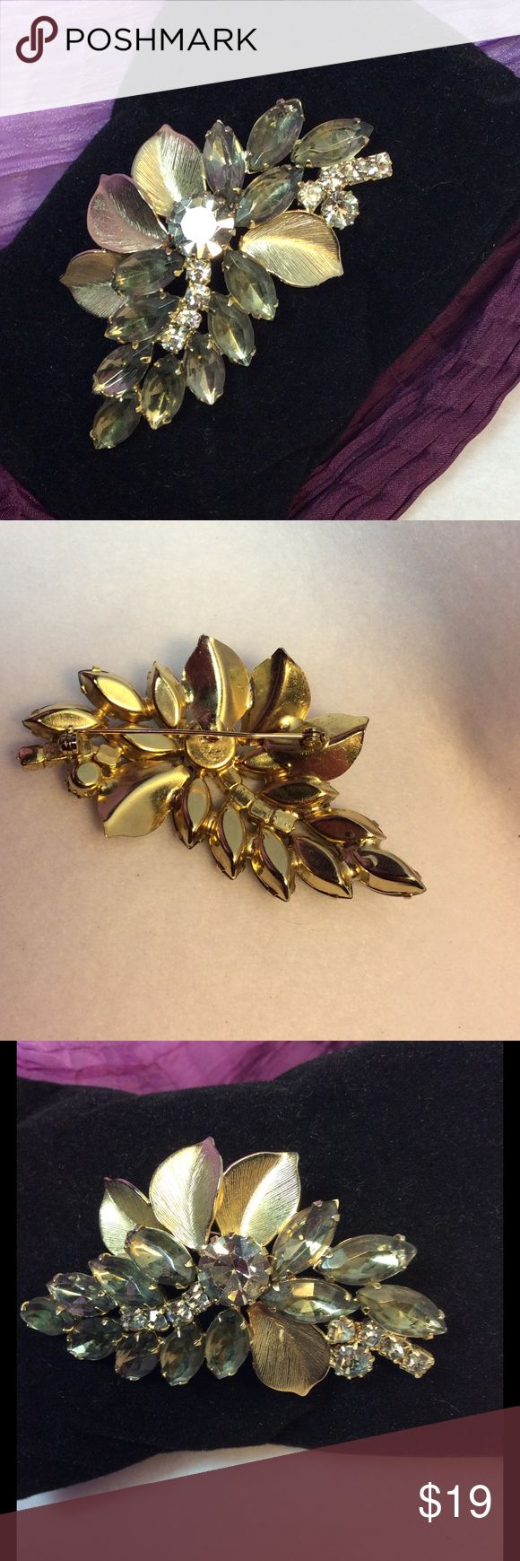 Goldtone Brooch with Clear and Smoky Stones Beautiful Vintage Brooch in Sparkling, yet neutral colors!  Would work with gold or silver jewelry!  Excellent size and shape for shoulder, collar, scarf, coat, and purse!  EUC.  Well taken care of, no defects or missing stones. Jewelry Brooches