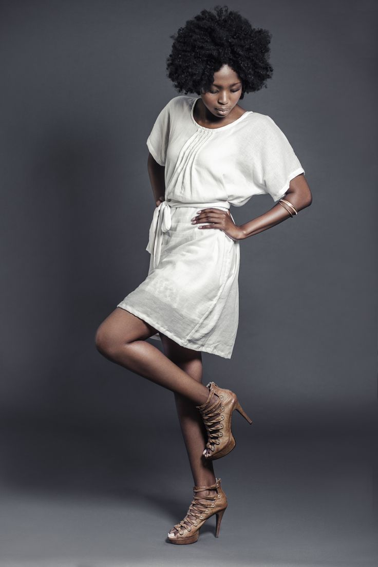 Ladies woven cotton gauze pin-tuck dress with tie detail. For more information visit: https://www.facebook.com/pengellyclothing or https://www.pengelly.co.za