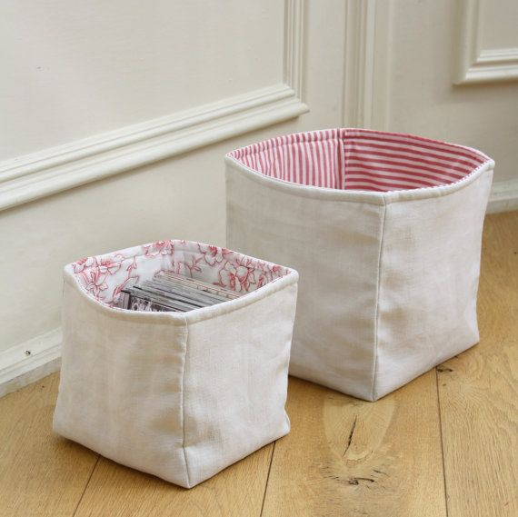plain fabric lined with patterned fabric storage bins for