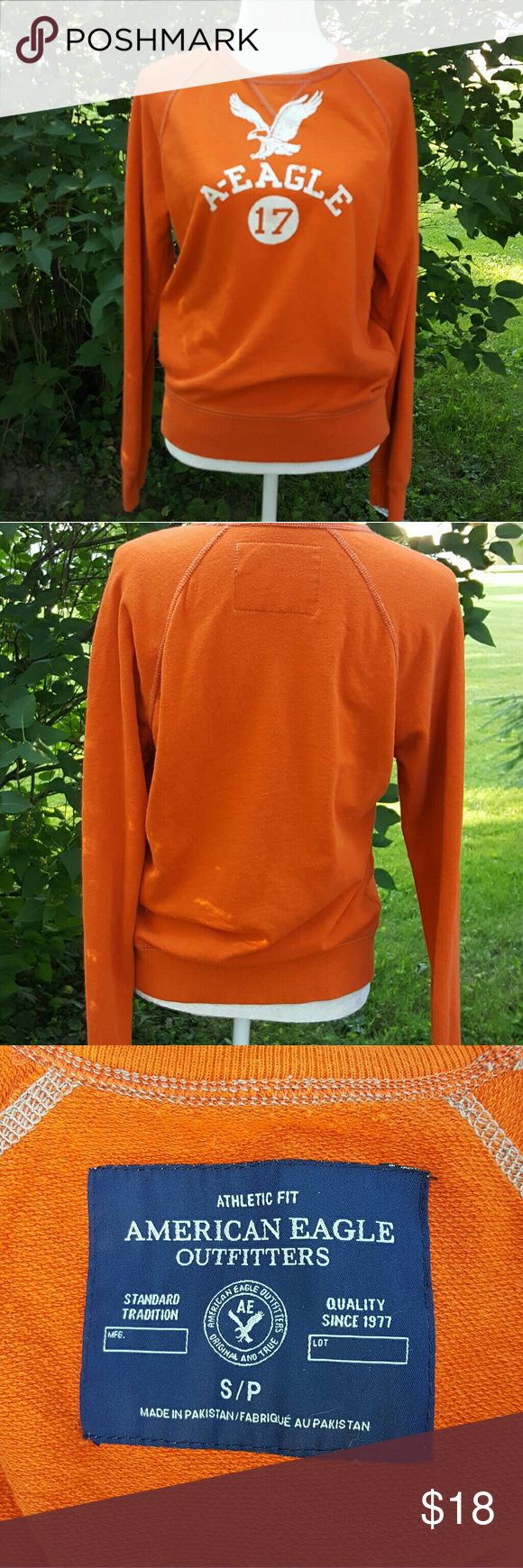 American Eagle Outfitter orange sweatshirt American Eagle Outfitter orange sweatshirt logo on front. size small runs big looks like it would fit a medium excellent condition American Eagle outfitters  Tops Sweatshirts & Hoodies