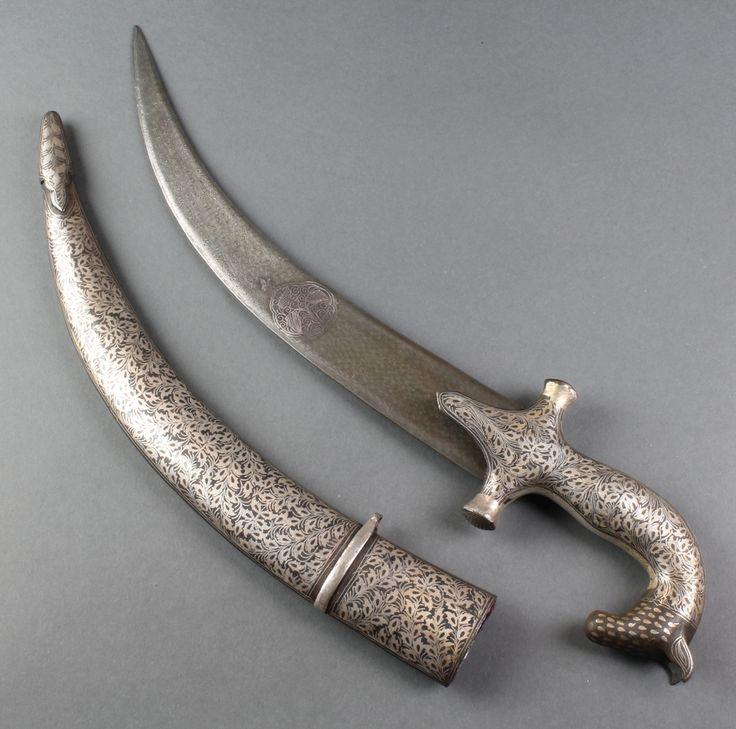 "Lot 219, A Jambiya style dagger with 12"" blade, and inlaid scabbard, est £60-90"