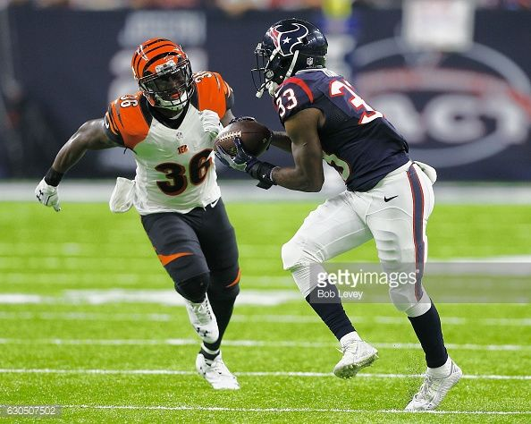 News Photo : Akeem Hunt of the Houston Texans runs with the...