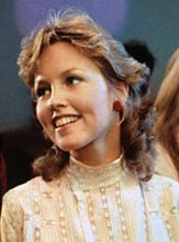 Deborah Foreman as Julie in Valley Girl wearing an ivory Edwardian style blouse with leg o mutton sleeves  that I loved. (also loved the music and young Nicholas Cage).
