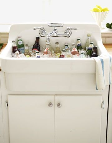 Quick #NewYearsEve party tip: Put your kitchen sink to work as a beverage cooler. Guests will feel welcome helping themselves, and cleanup's a breeze.Coolers, Parties Tips, Farms Sinks, Parties Ideas, Kitchen Sinks, Farmhouse Sinks, Drinks, Laundry Room, Kitchens Sinks