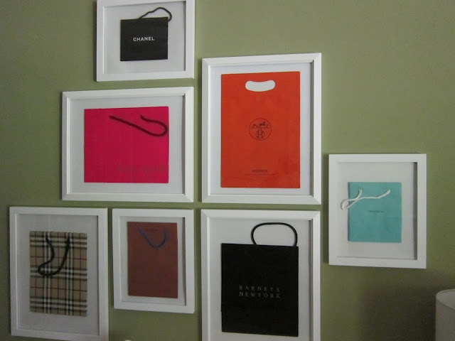 """Design Megillah: Decorating a Fasionista's Apartment    classic salon grouping (of designer shopping bags) is based on the frames coming together to form one or two straight lines and then """"branching out"""" from there."""