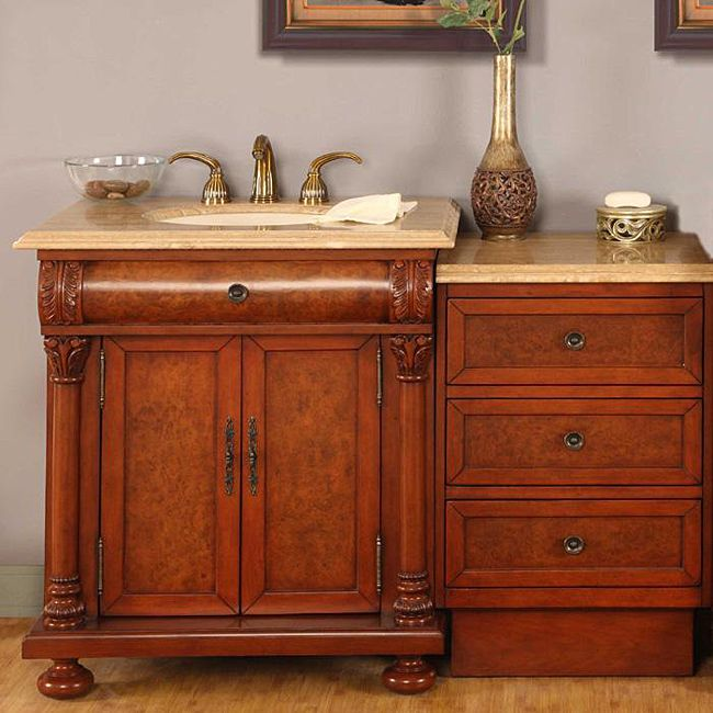 This LED light bathroom vanity set comes with a single sink vanity and a 3-drawer storage cabinet. This fully assembled bathroom vanity set includes a beige vien cut travertine stone countertop and an undermount ivory ceramic sink.