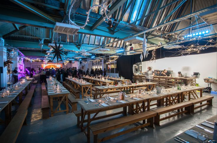 Restaurant area waiting for diners.. They're at the other end of the room enjoying a few cocktails :-) wooden benches and tables covered with hessian, hanging branches & cardboard stars