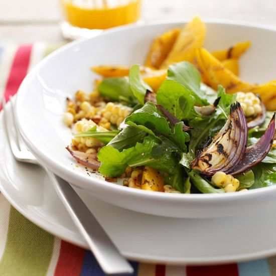 For a different kind of cookout dish, try this delicious summer salad of grilled corn, juicy mango, red onion, and arugula.