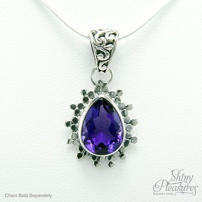 MAGNIFICENT Purple Amethyst Teardrop & Sterling Silver Pendant. Wow! What a stunning piece! The pictures barely do it justice. I can't decide what is more captivating, the decadent purple of the amethyst or the contemporary design and detail of the sterling silver surround. Expect compliments. The amethyst is genuine natural amethyst and the setting is solid sterling silver (NOT silver plated). $34.99 with FREE worldwide shipping!