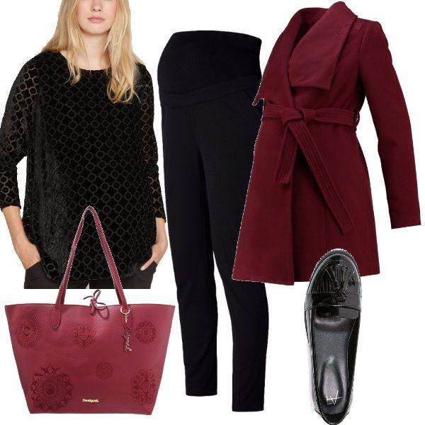 Un outfit comodo, pensato per l'ufficio, magari per il giorno dei saluti prima della maternità. Si basa sul nero e su diverse tonalità di bordeaux. La maglia è in velluto nero, con stampe geometriche, i pantaloni, anch'essi neri, sono comodi grazie alla fascia in vita. Scarpe basse, con nappine, cappotto corto bordeaux come la capiente borsa a mano, per completare l'outfit.