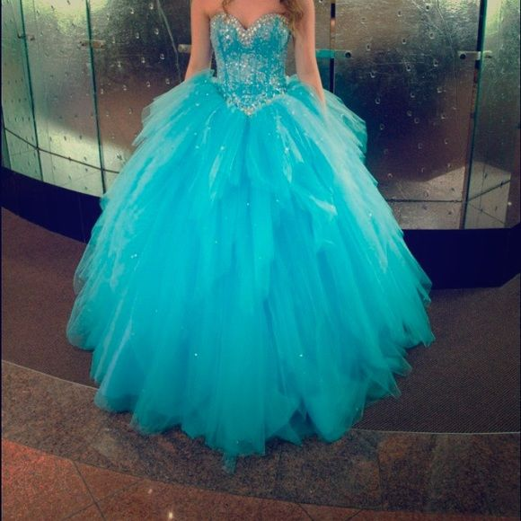 PROM DRESS Cinderella blue, has bra insert and corset back, I am 5,5 and could wear either sandals or heels . Corset back, could fit many sizes. Selling for 250 OBO Dresses Prom