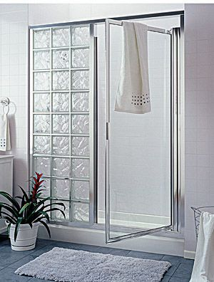 glass block shower within a frame, includes a door. I like this better than all open after the glass block wall, but perhaps not as much as all clear glass...