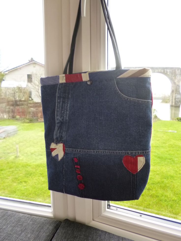 Made from recycle denim jeans. Lots of pockets and lined with Union jack fabric