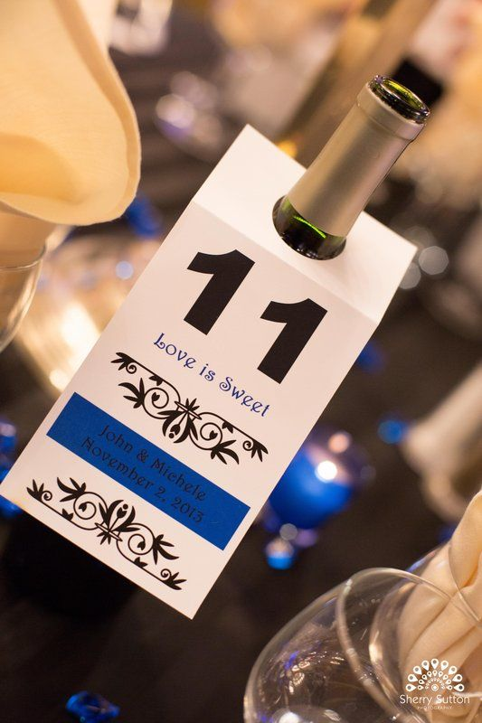 Fun table number detail for wine bottles at wedding. Love is sweet  Photo By Sherry Sutton Photography