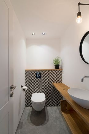 Love the idea of putting the same timber on top of the shelf behind toilet as timber used for vanity