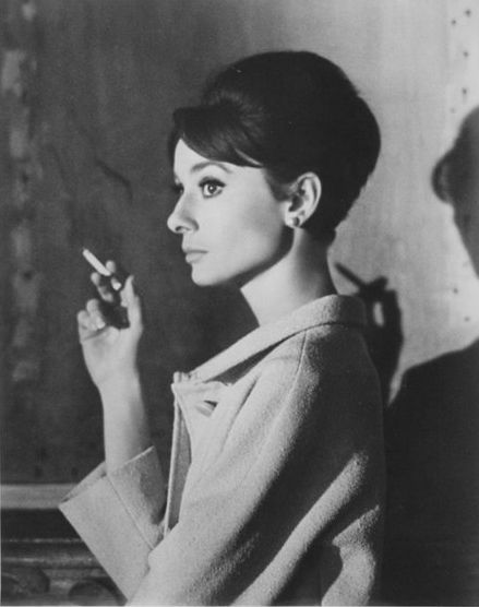 """""""Audrey Hepburn was a three-pack-a-day smoker."""" Audrey Hepburn smoking a cigarette during a break of filming Charade, 1963."""
