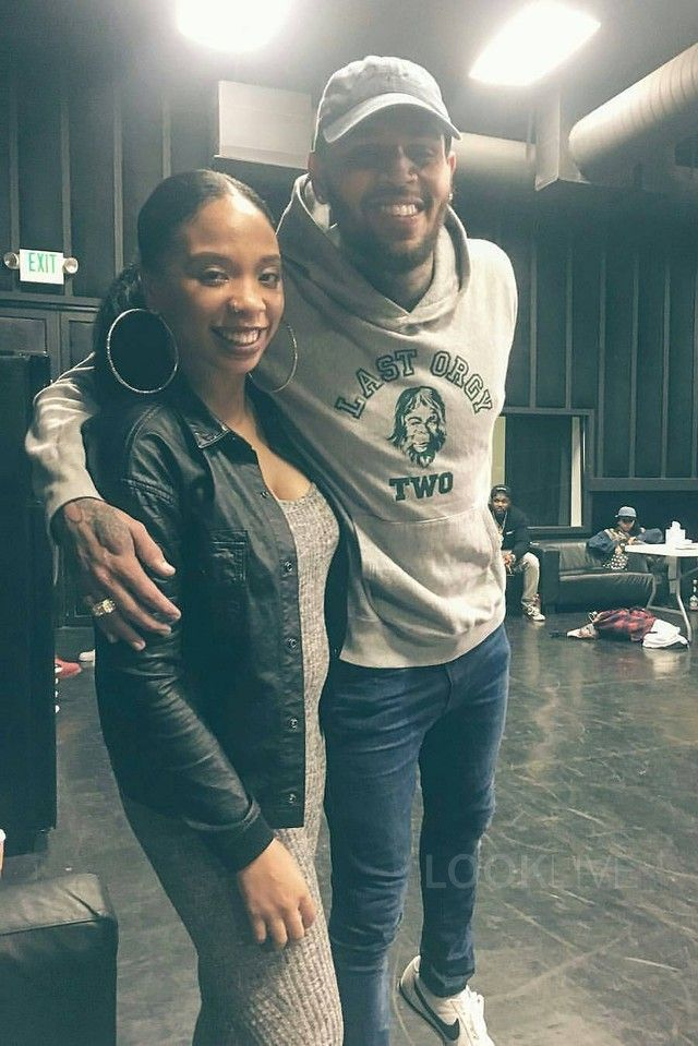 Chris Brown - Poses with one of his dancers