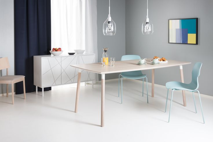 Lehti dining table and Viiva sideboard designed by Isko Lappalainen. Table accompanied by Stereo chairs.