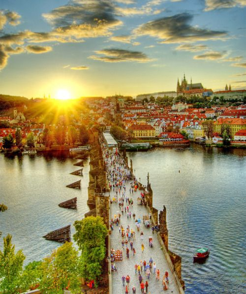 Sunset over Charles bridge in the old town of Prague, Czech Republic.