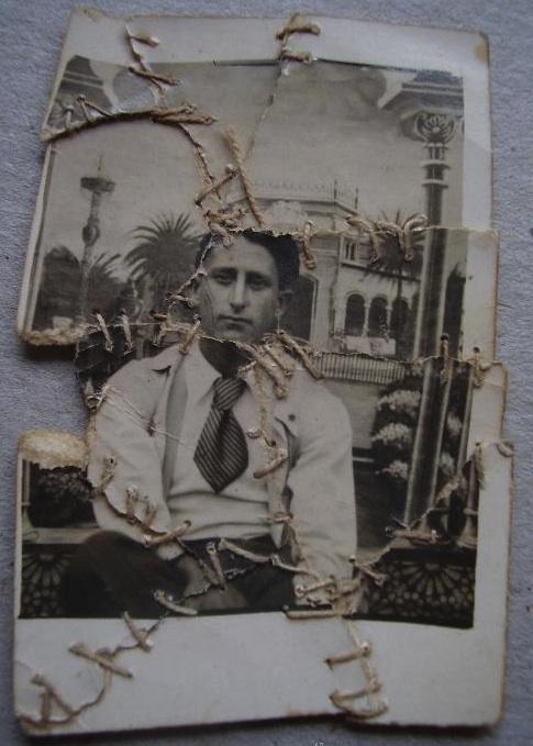 torn photo put back together - arrepentimiento